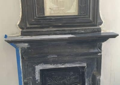 Restoration of cast iron fireplace in central London